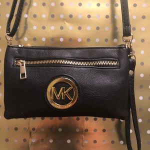 Authentic MK Black Leather/Gold trim Handbag